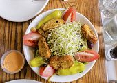 pic of alfalfa  - A beansprout salad with alfalfa bean sprouts tomato croutons pepper chick peas and green vegetables shot from the top.  ** Note: Soft Focus at 100%, best at smaller sizes - JPG