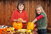 picture of jack o lanterns  - Kids carving their pumpkin jack - JPG