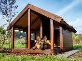 picture of shepherd dog  - German shepherd resting in its wooden kennel - JPG