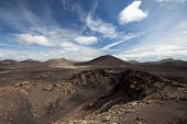 picture of cloud formation  - Volcanic landscape with cloud formation on Lanzarote - JPG