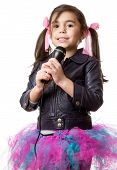image of singing  - young little girl with microphone singing on white background - JPG