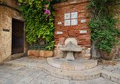 picture of bib tap  - Antique column on the street drinking Tarragona Spain - JPG