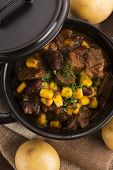 stock photo of stew  - Tasty winter traditional hot pot stew with meat and vegetables - JPG
