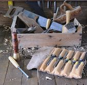 stock photo of workbench  - Old toolbox on the workbench in a carpentry - JPG