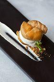 image of cream puff  - Cream puff cake and cream on a plate - JPG