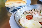 picture of sausage  - Vietnamese style fried egg in pan with white pork sausage Chinese sausage and pork  - JPG