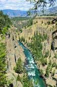 foto of calcite  - Calcite Springs near Tower Rosevelt in Yellowstone national park in summer - JPG