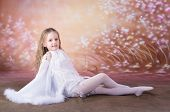 stock photo of shadoof  - young girl in long white dress with long hair in  the dance pose - JPG