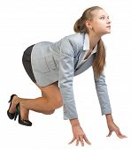 stock photo of start over  - Businesswoman standing in running start pose - JPG