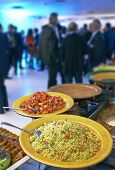 stock photo of catering service  - Catering service with lot of people in background - JPG