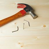 foto of fail job  - Hammering the nail to the wooden boards after the two failed attempts - JPG