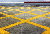 foto of transverse  - yellow transverse line on the raod the sign that car cannot parking there - JPG
