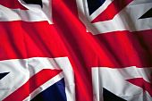 stock photo of rebs  - Picture of the United Kingdom flag with wavy texture - JPG