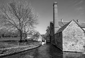 stock photo of water-mill  - Black and White photograph of a water mill in the Cotswold village of Lower Slaughter - JPG