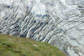 stock photo of crevasse  - Meadow and crevasses in glacier  - JPG