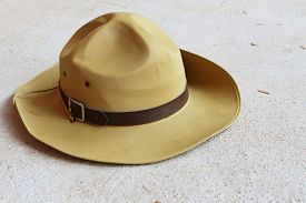 image of boy scout  - boy scout hat is on the concrete floor - JPG