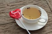 image of valentine candy  - Hot tea in glass and candy sweet valentines heart - JPG