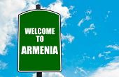 foto of armenia  - Green road sign with greeting message WELCOME TO ARMENIA isolated over clear blue sky background with available copy space - JPG