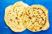picture of flat-bread  - Pita bread flat bread pita tortilla on a blue wooden background - JPG