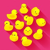 stock photo of duck  - Yellow rubber duck against the pink background - JPG