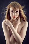 stock photo of aroused  - sensual topless woman cover her naked body - JPG