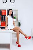 pic of provocative  - sexy provocative businesswoman at office sitting on table - JPG