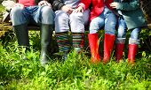 picture of boot  - Happy family wearing colorful rain boots - JPG