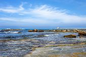 stock photo of dam  - seascape of livorno coast with dam and lighthouse in the background  - JPG