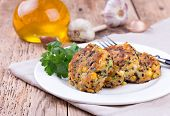 stock photo of veggie burger  - Vegetarian patties or burger made with chickpeas on white plate - JPG