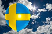 picture of sweden flag  - balloon in colors of sweden flag flying on blue sky