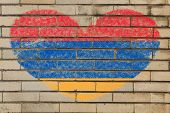 picture of armenia  - heart shaped flag in colors of armenia on brick wall - JPG