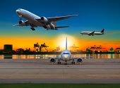 image of logistics  - cargo plane flying over airport against beautiful morning light in ship yard use for transportation and logistic industry business - JPG