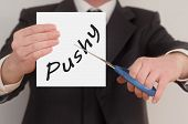 foto of pushy  - Pushy man in suit cutting text on paper with scissors - JPG