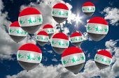 Постер, плакат: Many Balloons With Iraq Flag On Sky