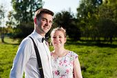 stock photo of fiance  - Young couple in love portrait in summer park - JPG