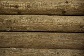 stock photo of log fence  - Wooden wall of logs as background - JPG