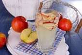 pic of cider apples  - Glass of apple cider with fruits on table close up - JPG