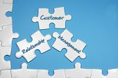 pic of customer relationship management  - Customer Relationship Management word on white puzzle  - JPG