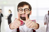 stock photo of suspenders  - Funny handsome man wearing suspenders with ok sign - JPG