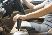 picture of gear-shifter  - Business women are changing gears in the drive - JPG