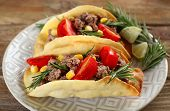 pic of tacos  - Mexican food Tacos in plate on wooden table - JPG