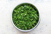 picture of fenugreek  - finely chopped fenugreek leaves kept in a bowl on a blurred background - JPG