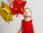 Постер, плакат: Little Baby Girl With Colorful Shiny Foil Balloons