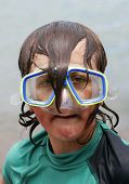 stock photo of dorky  - boy with diving mask on looking like a right plonker - JPG