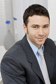 picture of young adult  - Portrait of happy young businessman at office - JPG