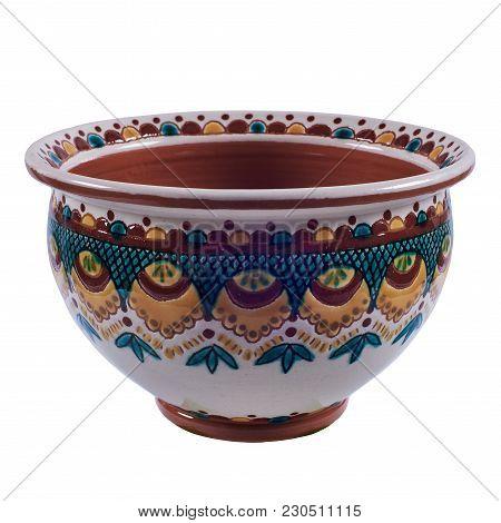 Постер, плакат: Colorful Covered With Glaze Ceramic Handmade Pot Painting In The Technique Kosovo Ceramics It Rea, холст на подрамнике