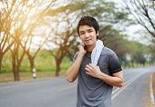 Young Sporty Man Resting And Wiping His Sweat With A Towel After Workout Sport Exercises Outdoors At poster