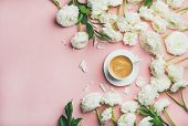 Spring Morning Concept. Flat-lay Of Cup Of Coffee Surrounded With White Ranunculus Flowers Over Ligh poster