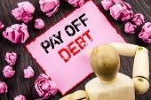 Conceptual Hand Text Showing Pay Off Debt. Concept Meaning Reminder To Paying Owed Financial Credit  poster