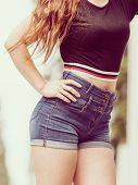 Woman Showing Her Sexy Curves. Hips And Legs Body Part In Short Denim Shorts. poster